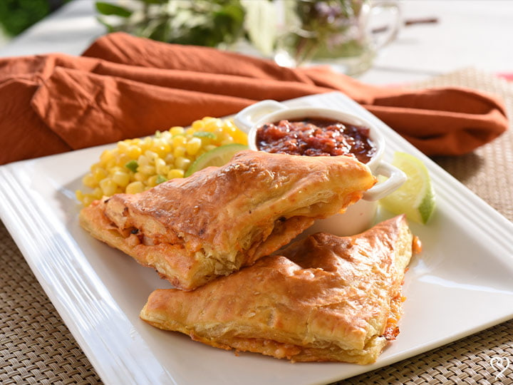 Chicken and Cheddar Empanadas with Key Lime Corn